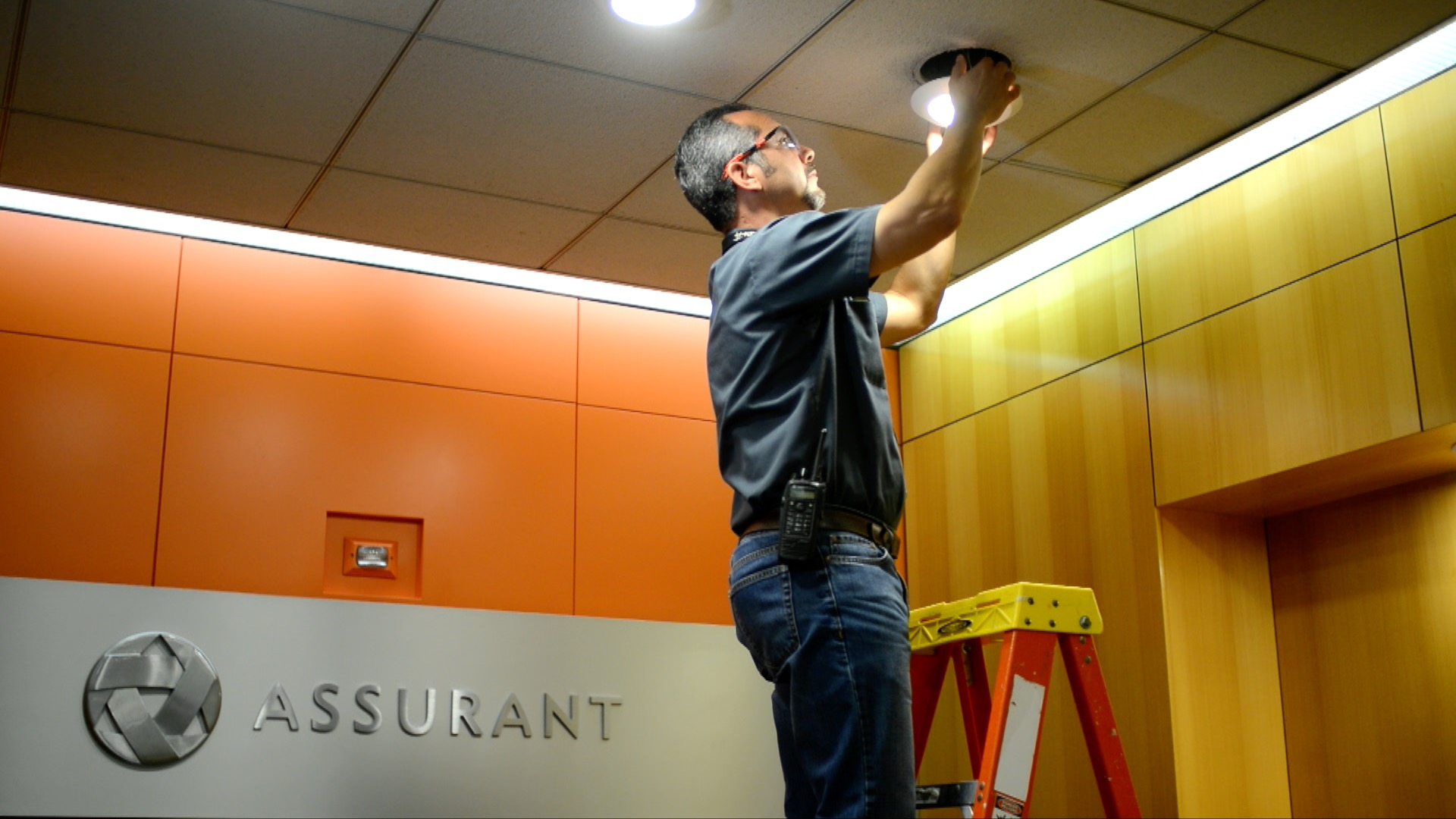 Employee Changes Light at Assurant Office